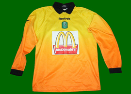Goalkeeper Sporting shirt match worn by a young football player