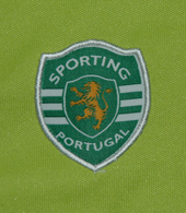 Trousers of a track suit of a young player from a Sporting Lisbon football school. Size child 14 years