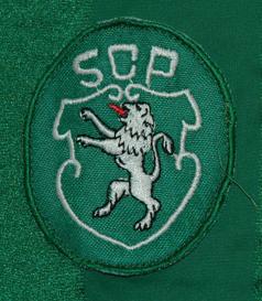 1984/86. Equipamento Le Coq Sportif alternativo de mangas curtas, verde