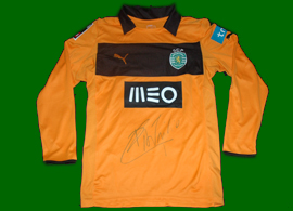 Sporting 2012/2013. Equipamento cor de laranja de guarda redes do Rui Patrício de jogo