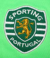 2009/10. Shocking green away strip