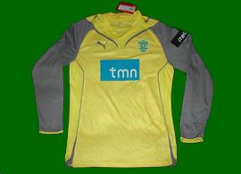 Equipamento de guarda-redes do Sporting amarelo com mangas cinzentas