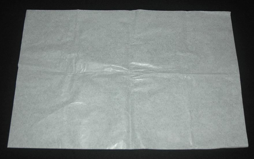 estender uma folha de papel anti-ácido grande