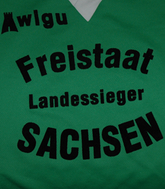 Green white shirt, unknown details. From Saxony in Germany
